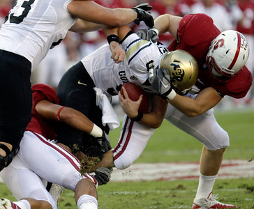 Colorado quarterback Tyler Hansen (9) is sacked by Stanford linebacker Trent Murphy (93) in the second quarter of an NCAA college football game in Stanford, Calif., Saturday, Oct. 8, 2011. (AP Photo/Paul Sakuma)