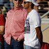Former Denver Broncos quarterback John Elway, left, talks with golfer Tiger Woods, right, during the first quarter of an NCAA college football game between Stanford and Colorado in in Stanford, Calif., Saturday, Oct. 8, 2011. (AP Photo/Paul Sakuma)