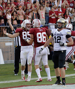 Stanford fullback Ryan Hewitt (85) is congratulated by tight end Zach Ertz (86) after he scored past Colorado linebacker Patrick Mahnke (12) in the second quarter of an NCAA college football game in Stanford, Calif., Saturday, Oct. 8, 2011. (AP Photo/Paul Sakuma)