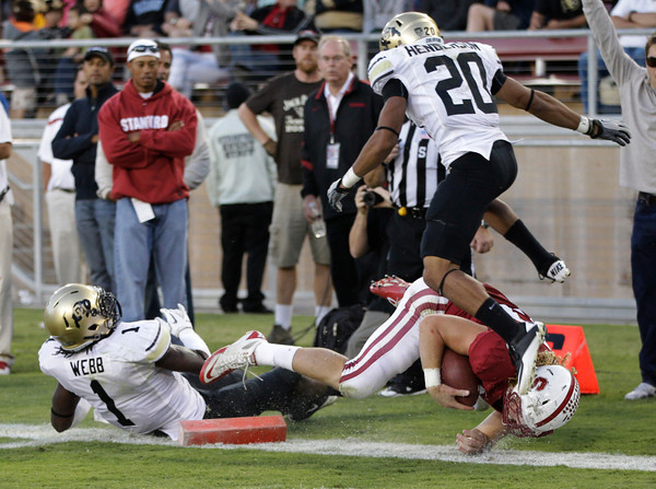 Stanford fullback Ryan Hewitt (85) scores a touchdown in front of Colorado defensive back Greg Henderson (20) and linebacker Derrick Webb (1) as golfer Tiger Woods, upper left, watches in the third quarter of an NCAA college football game in Stanford, Calif., Saturday, Oct. 8, 2011. (AP Photo/Paul Sakuma)