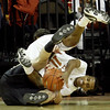 Colorado guard Nate Thompson, bottom, from Australia, is called for a foul as he battles for the ball with Texas guard Jai Lucas during first half action in an NCAA college basketball game Saturday, Jan. 9, 2010, in Austin, Texas. (AP Photo/Harry Cabluck)