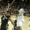 Texas forward Damion James, right, grabs a defensive rebound behind Colorado forward Marcus Relphorde, left, during first half action in an NCAA college basketball game, Saturday,  Jan. 9, 2010, in Austin, Texas. (AP Photo/Harry Cabluck)