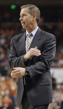 Colorado coach Jeff Brzdelik reacts to a play during first half action in his team's 103-86 loss to Texas in an NCAA college basketball game, Saturday,  Jan. 9, 2010, in Austin, Texas. (AP Photo/Harry Cabluck)