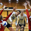 """Anicia Santos, 10, of the University of Colorado hits the ball past Utah's Chelsey Schofield, 11, and Erin Redd, 17, at the Coors Events Center on Tuesday. For more photos from the game go to  <a href=""""http://www.buffzone.com"""">http://www.buffzone.com</a><br /> Photo by Paul Aiken / The Camera / September 13, 2011"""