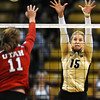 "Nikki Lindow, 15, of the University of Colorado goes for a block against Chelsey Schofield, 11, in CU's game against Utah at the Coors Events Center on Tuesday. For more photos from the game go to  <a href=""http://www.buffzone.com"">http://www.buffzone.com</a><br /> Photo by Paul Aiken / The Camera / September 13, 2011"