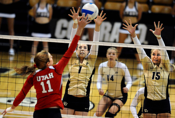 "Kelsey English, 1, and Nikki Lindow, 15, of the University of Colorado blocks against Utah's  Chelsey Schofield, 11, at the Coors Events Center on Tuesday. For more photos from the game go to  <a href=""http://www.buffzone.com"">http://www.buffzone.com</a><br /> Photo by Paul Aiken / The Camera / September 13, 2011"