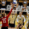 """Kelsey English, 1, and Nikki Lindow, 15, of the University of Colorado blocks against Utah's  Chelsey Schofield, 11, at the Coors Events Center on Tuesday. For more photos from the game go to  <a href=""""http://www.buffzone.com"""">http://www.buffzone.com</a><br /> Photo by Paul Aiken / The Camera / September 13, 2011"""