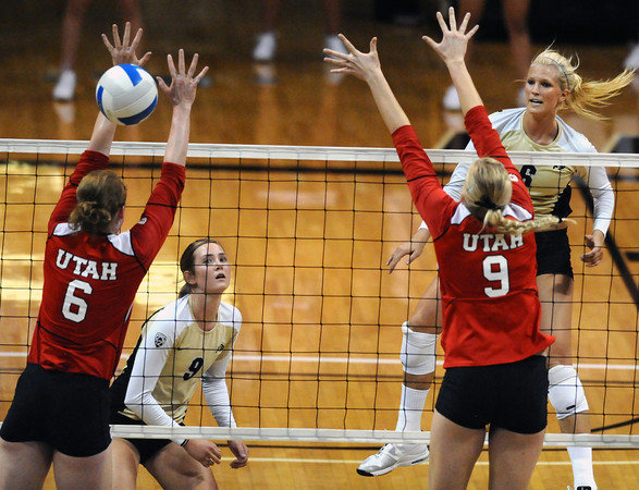 """Kerra Schroeder, 6, of the University of Colorado hits against Utah's Morgan Odale, 6, and Danielle Killpack, 9, at the Coors Events Center on Tuesday. For more photos from the game go to  <a href=""""http://www.buffzone.com"""">http://www.buffzone.com</a><br /> Photo by Paul Aiken / The Camera / September 13, 2011"""