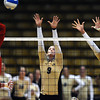 "Alyssa Valentine, 8, and Nikki Lindow, 15, of the University of Colorado goe for a block against Utah's Chelsey Schofield, 11, in CU's game against Utah at the Coors Events Center on Tuesday. For more photos from the game go to  <a href=""http://www.buffzone.com"">http://www.buffzone.com</a><br /> Photo by Paul Aiken / The Camera / September 13, 2011"