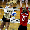 """Nikki Lindow, 15, of the University of Colorado goes for a spike against Utah's Morgan Odale, 6, at the Coors Events Center on Tuesday. For more photos from the game go to  <a href=""""http://www.buffzone.com"""">http://www.buffzone.com</a><br /> Photo by Paul Aiken / The Camera / September 13, 2011"""