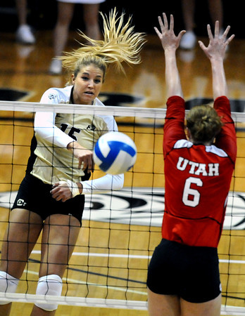 "Nikki Lindow, 15, of the University of Colorado goes for a spike against Utah's Morgan Odale, 6, at the Coors Events Center on Tuesday. For more photos from the game go to  <a href=""http://www.buffzone.com"">http://www.buffzone.com</a><br /> Photo by Paul Aiken / The Camera / September 13, 2011"