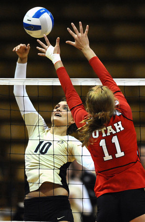 "Anicia Santos, 10, of the University of Colorado hits against Utah's Chelsey Schofield, 11, at the Coors Events Center on Tuesday. For more photos from the game go to  <a href=""http://www.buffzone.com"">http://www.buffzone.com</a><br /> Photo by Paul Aiken / The Camera / September 13, 2011"