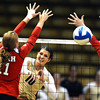 "Anicia Santos, 10, of the University of Colorado hits the ball past Utah's Chelsey Schofield, 11, at the Coors Events Center on Tuesday. For more photos from the game go to  <a href=""http://www.buffzone.com"">http://www.buffzone.com</a><br /> Photo by Paul Aiken / The Camera / September 13, 2011"