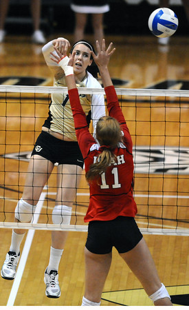 "Kelsey English, 1, of the University of Colorado hits against Utah's  Chelsey Schofield, 11, at the Coors Events Center on Tuesday. For more photos from the game go to  <a href=""http://www.buffzone.com"">http://www.buffzone.com</a><br /> Photo by Paul Aiken / The Camera / September 13, 2011"