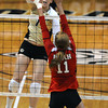 """Kelsey English, 1, of the University of Colorado hits against Utah's  Chelsey Schofield, 11, at the Coors Events Center on Tuesday. For more photos from the game go to  <a href=""""http://www.buffzone.com"""">http://www.buffzone.com</a><br /> Photo by Paul Aiken / The Camera / September 13, 2011"""