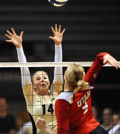 "Emily Alexis, 14, of the University of Colorado goes for a block against Utah's Danielle Killpack, 9,  at the Coors Events Center on Tuesday. For more photos from the game go to  <a href=""http://www.buffzone.com"">http://www.buffzone.com</a><br /> Photo by Paul Aiken / The Camera / September 13, 2011"