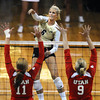 """Kerra Schroeder, 6, of the University of Colorado hits against Utah's Chelsey Schofield, 11, and Danielle Killpack, 9,  at the Coors Events Center on Tuesday. For more photos from the game go to  <a href=""""http://www.buffzone.com"""">http://www.buffzone.com</a><br /> Photo by Paul Aiken / The Camera / September 13, 2011"""