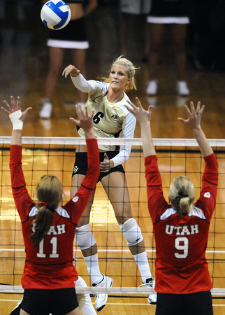 "Kerra Schroeder, 6, of the University of Colorado hits against Utah's Chelsey Schofield, 11, and Danielle Killpack, 9,  at the Coors Events Center on Tuesday. For more photos from the game go to  <a href=""http://www.buffzone.com"">http://www.buffzone.com</a><br /> Photo by Paul Aiken / The Camera / September 13, 2011"
