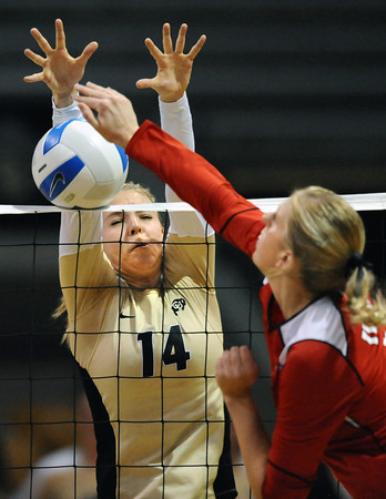 """Emily Alexis, 14, of the University of Colorado goes for a block against Utah's Danielle Killpack, 9,  at the Coors Events Center on Tuesday. For more photos from the game go to  <a href=""""http://www.buffzone.com"""">http://www.buffzone.com</a><br /> Photo by Paul Aiken / The Camera / September 13, 2011"""
