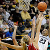 "University of Colorado's Chucky Jeffery takes a shot over Wisconsin defenders on Saturday, Nov. 26, during a basketball game against the University of Wisconsin at the Coors Event Center on the CU campus in Boulder. For more photos of the game go to  <a href=""http://www.dailycamera.com"">http://www.dailycamera.com</a><br /> Photo by Jeremy Papasso"
