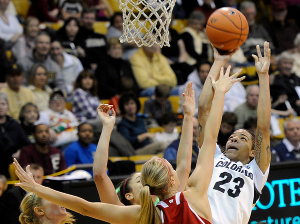"""University of Colorado's Chucky Jeffery takes a shot over Wisconsin defenders on Saturday, Nov. 26, during a basketball game against the University of Wisconsin at the Coors Event Center on the CU campus in Boulder. For more photos of the game go to  <a href=""""http://www.dailycamera.com"""">http://www.dailycamera.com</a><br /> Photo by Jeremy Papasso"""