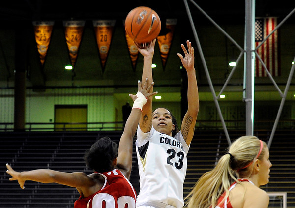 "University of Colorado's Chucky Jeffery shoots a three-pointer over Wisconsin's Jade Davis on Saturday, Nov. 26, during a basketball game against the University of Wisconsin at the Coors Event Center on the CU campus in Boulder. For more photos of the game go to  <a href=""http://www.dailycamera.com"">http://www.dailycamera.com</a><br /> Photo by Jeremy Papasso"