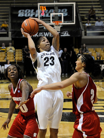 "University of Colorado's Chucky Jeffery takes a shot over Wisconsin's Taylor Wurtz on Saturday, Nov. 26, during a basketball game against the University of Wisconsin at the Coors Event Center on the CU campus in Boulder. For more photos of the game go to  <a href=""http://www.dailycamera.com"">http://www.dailycamera.com</a><br /> Photo by Jeremy Papasso"