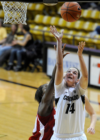 "University of Colorado's Meagan Malcolm-Peck takes a shot over Wisconsin's Anya Covington on Saturday, Nov. 26, during a basketball game against the University of Wisconsin at the Coors Event Center on the CU campus in Boulder. For more photos of the game go to  <a href=""http://www.dailycamera.com"">http://www.dailycamera.com</a><br /> Photo by Jeremy Papasso"