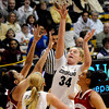 "University of Colorado's Jen Reese sinks a two-pointer on Saturday, Nov. 26, during a basketball game against the University of Wisconsin at the Coors Event Center on the CU campus in Boulder. For more photos of the game go to  <a href=""http://www.dailycamera.com"">http://www.dailycamera.com</a><br /> Photo by Jeremy Papasso"