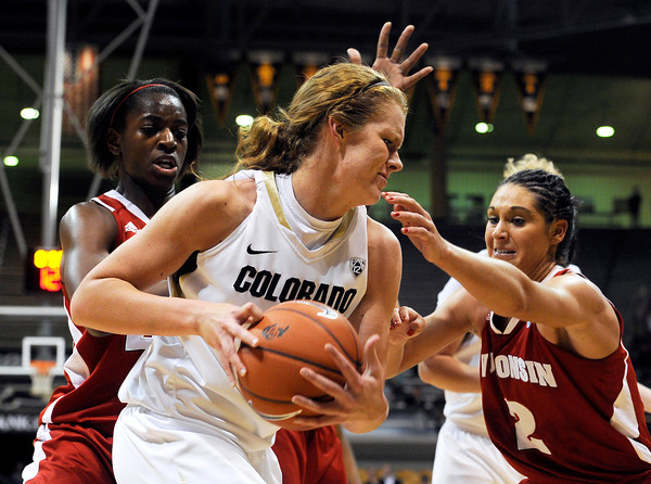 "University of Colorado's Rachel Hargis fights for the rebound with Wisconsin's Taylor Wurtz, right, and Anya Covington on Saturday, Nov. 26, during a basketball game against the University of Wisconsin at the Coors Event Center on the CU campus in Boulder. For more photos of the game go to  <a href=""http://www.dailycamera.com"">http://www.dailycamera.com</a><br /> Photo by Jeremy Papasso"