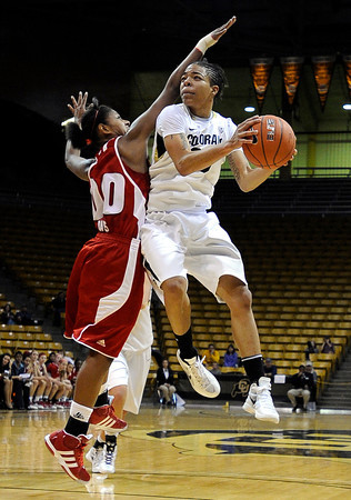 """University of Colorado's Chucky Jeffery goes for a layup under the arms of Wisconsin's Jade Davis on Saturday, Nov. 26, during a basketball game against the University of Wisconsin at the Coors Event Center on the CU campus in Boulder. For more photos of the game go to  <a href=""""http://www.dailycamera.com"""">http://www.dailycamera.com</a><br /> Photo by Jeremy Papasso"""