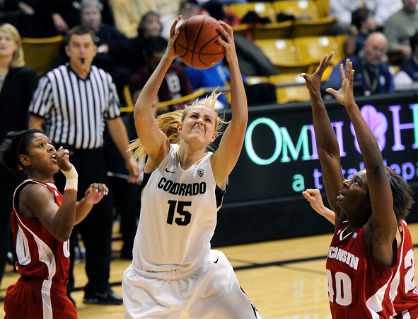 """University of Colorado's Julie Seabrook snags a rebound on Saturday, Nov. 26, during a basketball game against the University of Wisconsin at the Coors Event Center on the CU campus in Boulder. For more photos of the game go to  <a href=""""http://www.dailycamera.com"""">http://www.dailycamera.com</a><br /> Photo by Jeremy Papasso"""