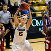 "University of Colorado's Julie Seabrook snags a rebound on Saturday, Nov. 26, during a basketball game against the University of Wisconsin at the Coors Event Center on the CU campus in Boulder. For more photos of the game go to  <a href=""http://www.dailycamera.com"">http://www.dailycamera.com</a><br /> Photo by Jeremy Papasso"