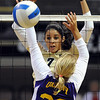 "Neira Ortiz Ruiz of CU stuffs the shot of Brooke Stanley of Albany.<br /> For more photos of the game, go to  <a href=""http://www.dailycamera.com"">http://www.dailycamera.com</a>.<br />  Cliff Grassmick / September 4, 2011"