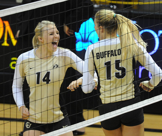 "Emily Alexis (14) and Nikki Lindow of CU celebrate a point against Albany.<br /> For more photos of the game, go to  <a href=""http://www.dailycamera.com"">http://www.dailycamera.com</a>.<br />  Cliff Grassmick / September 4, 2011"