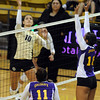 "Anicia Santos of Colorado tries to hit past Gabby Whitworth of Albany.<br /> For more photos of the game, go to  <a href=""http://www.dailycamera.com"">http://www.dailycamera.com</a>.<br />  Cliff Grassmick / September 4, 2011"