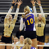 "Kelsey English (1) and Nikki Lindow, both of CU, go up to block Casey Wright of Albany.<br /> For more photos of the game, go to  <a href=""http://www.dailycamera.com"">http://www.dailycamera.com</a>.<br />  Cliff Grassmick / September 4, 2011"