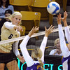 "Kerra Schroeder of CU tries to hit past Brooke Stanley (22) of Albany.<br /> For more photos of the game, go to  <a href=""http://www.dailycamera.com"">http://www.dailycamera.com</a>.<br />  Cliff Grassmick / September 4, 2011"