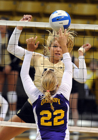 "Nikkie Lindow of CU hits a shot back on Brooke Stanley of Albany.<br /> For more photos of the game, go to  <a href=""http://www.dailycamera.com"">http://www.dailycamera.com</a>.<br />  Cliff Grassmick / September 4, 2011"