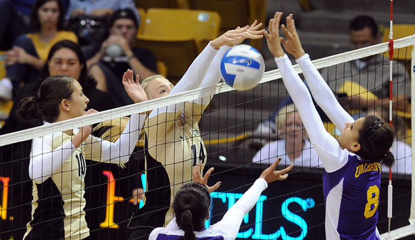 "Emily Alexis of CU stuffs a hit against Vanessa Sheffield of Albany.<br /> For more photos of the game, go to  <a href=""http://www.dailycamera.com"">http://www.dailycamera.com</a>.<br />  Cliff Grassmick / September 4, 2011"