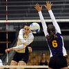 "Kelsey English of CU hits past Samantha Brostrom of Albany.<br /> For more photos of the game, go to  <a href=""http://www.dailycamera.com"">http://www.dailycamera.com</a>.<br />  Cliff Grassmick / September 4, 2011"