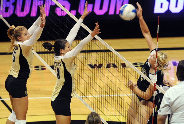 "Nikki Lindow, left, and Anicia Santos, both of CU, try to block the shot of Andrea Spaustat of UNC.<br /> For more photos of the game, go to  <a href=""http://www.dailycamera.com"">http://www.dailycamera.com</a>.<br />  Cliff Grassmick / August 28, 2011"