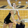 "Kelsey English of CU hits past Alyssa Wilson of UNC.<br /> For more photos of the game, go to  <a href=""http://www.dailycamera.com"">http://www.dailycamera.com</a>.<br />  Cliff Grassmick / August 28, 2011"