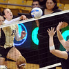 "Lydia Blaha of CU hits past Kelley Arnold of UNC.<br /> For more photos of the game, go to  <a href=""http://www.dailycamera.com"">http://www.dailycamera.com</a>.<br />  Cliff Grassmick / August 28, 2011"