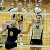 "Andrea Spaustat of UNC hits into Anicia Santos of CU.<br /> For more photos of the game, go to  <a href=""http://www.dailycamera.com"">http://www.dailycamera.com</a>.<br />  Cliff Grassmick / August 28, 2011"