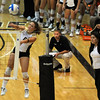 Richi Bigelow of Colorado hits as coach Liz Kritza looks on.<br /> Cliff Grassmick / August 27, 2010