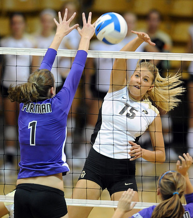 Nichole Lindow  of Colorado hits past Phoebe Maglathlin of Furman.<br /> Cliff Grassmick / August 27, 2010