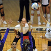 Kerra Schroeder of Colorado hits the ball past the Furman defense on Friday.<br /> Cliff Grassmick / August 27, 2010