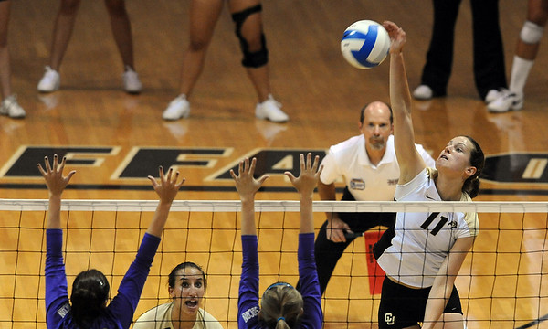 Rosie Steinhaus of Colorado hits past the Furman defense on Friday.<br /> Cliff Grassmick / August 27, 2010