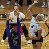 Kerra Schroeder of CU hits past Christina Curry of Furman.<br /> Cliff Grassmick / August 27, 2010